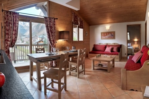 An artist's impression of an example of the lounge area of a Two Bedroom Apartment in L'Oree Des Neiges, Vallandry, France