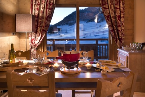 An artist's impression of an example of a dining room in a Three Bedroom Apartment in L'Oree des Neiges, Vallandry, France