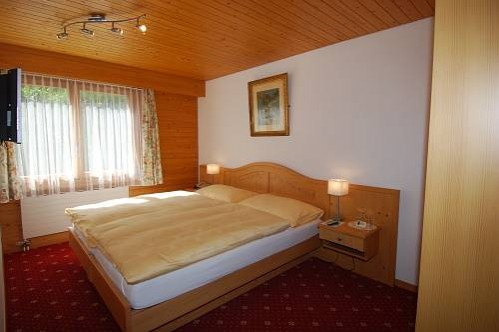The Bedroom of a Family Suite in the Hotel Eiger - Murren