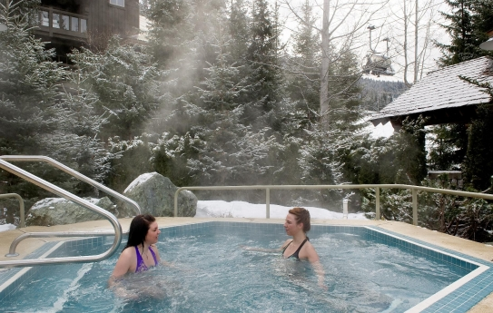 The outdoor hot tub at the Coast Blackcomb Suites at Whistler