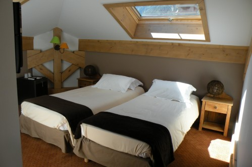 An example of a bedroom at the Hotel Gourmets and Italy in Chamonix