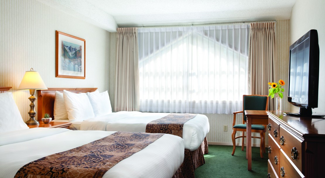 Stretch out in queen size beds at the Listel in Whistler.