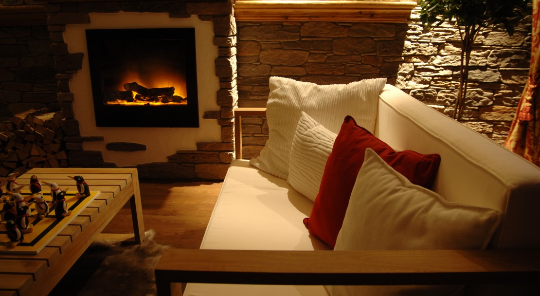 Sofa by the fire at the Hotel Beau-Site in Adelboden