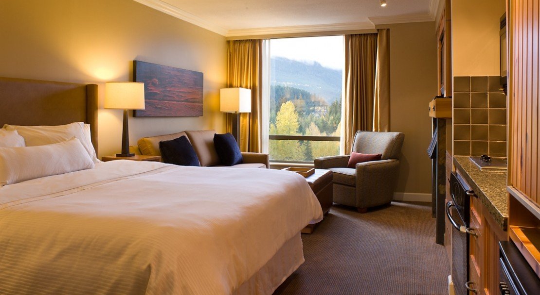 A junior suite with open plan kitchen and excellent views of Whistler and the surrounding mountainside.