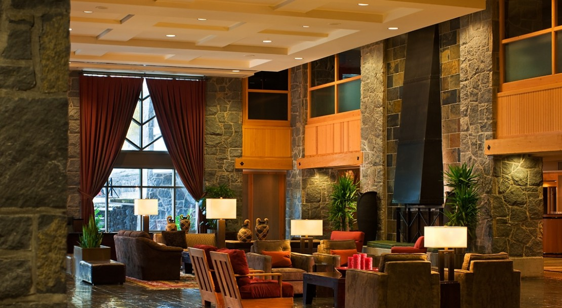 The spacious lobby with open fireplace and high ceilings is idea to relax in.