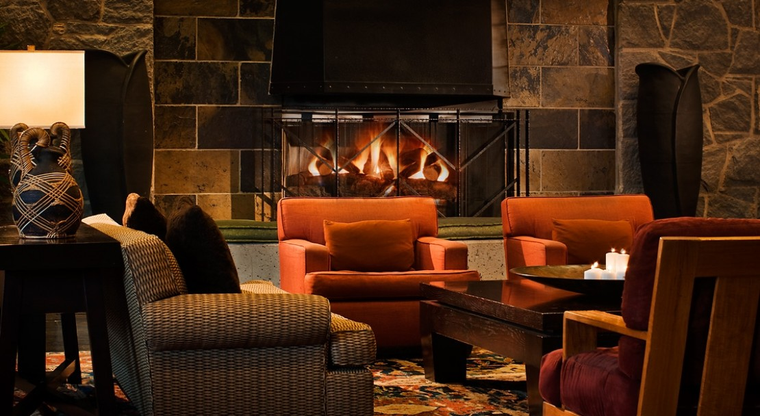 The lobby enjoys a beautiful open fire with comfortable seating.