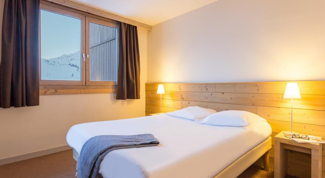 Double bedroom at Les Gemeaux P&V La Plagne