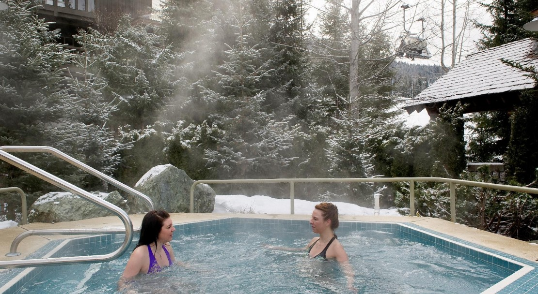 The outdoor hot tub at Coast Blackcomb Suites