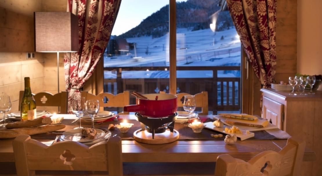 An example of what a dining room might look like in an apartment in L'Oree des Neiges, Vallandry, France