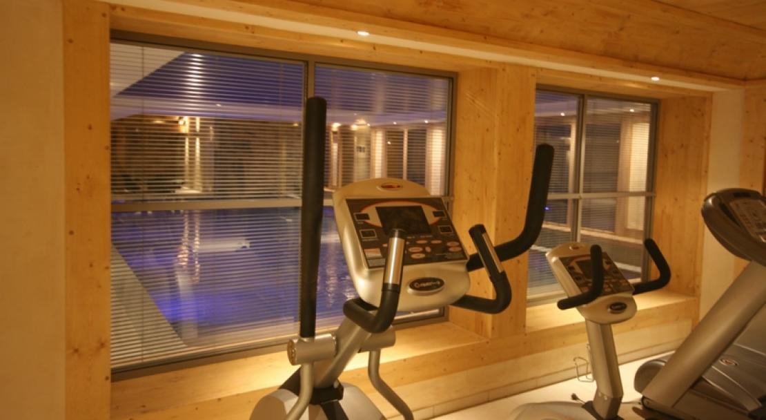 The fitness suite overlooking the swimming pool at Le Village de Lessy, Le Grand-Bornand/ Chinaillon, France
