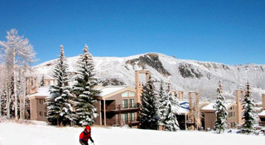 A skier going by the Timberline Condos in Aspen Snowmass - USA