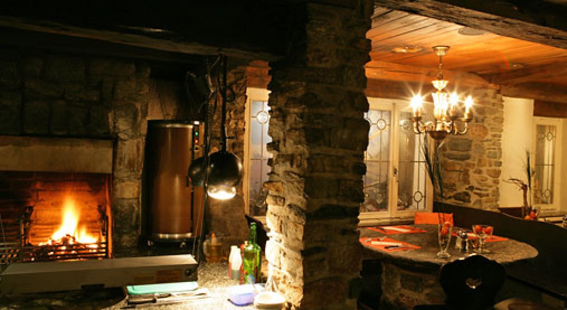 Relax by the beautiful fire in the cosy bar in Saas Fee