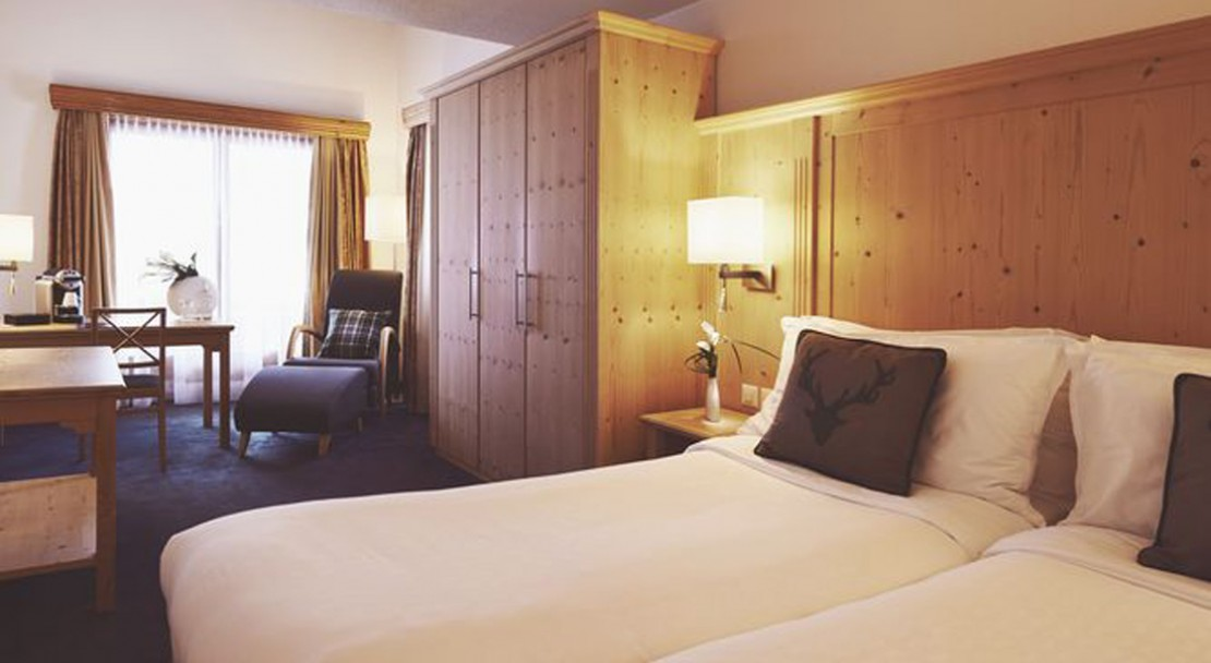 An example of a bedroom at the Sheraton Davos Hotel Waldhuus, Switzerland.