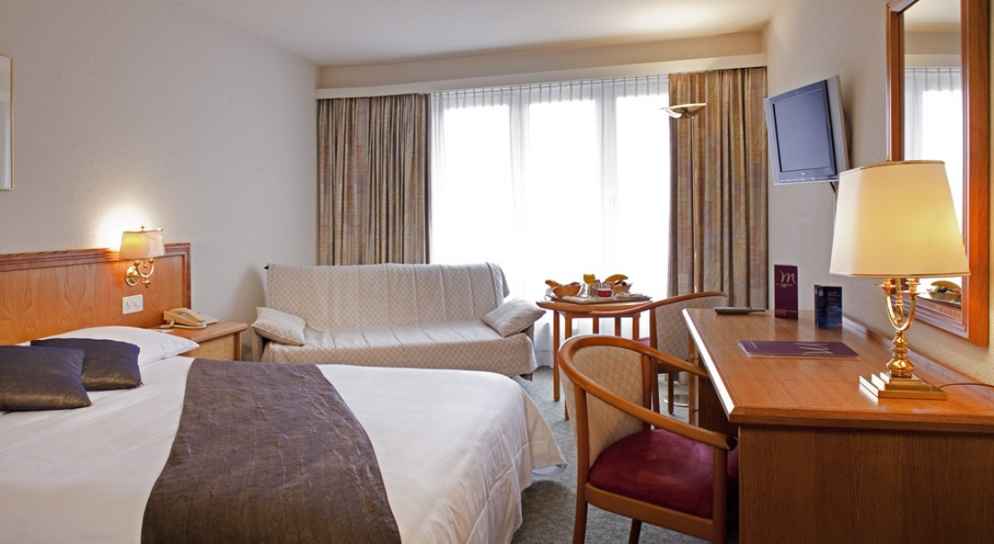 A clean and spacious bedroom in the Mercure Classic Hotel Leysin