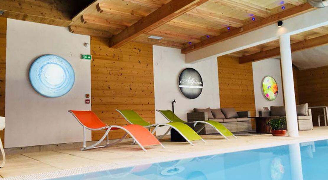 Hotel Alpina Enclosed indoor windows heated swimming pool loungers Morzine
