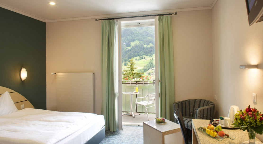 A Bedroom at the Belvedere Swiss Q Hotel Grindelwald