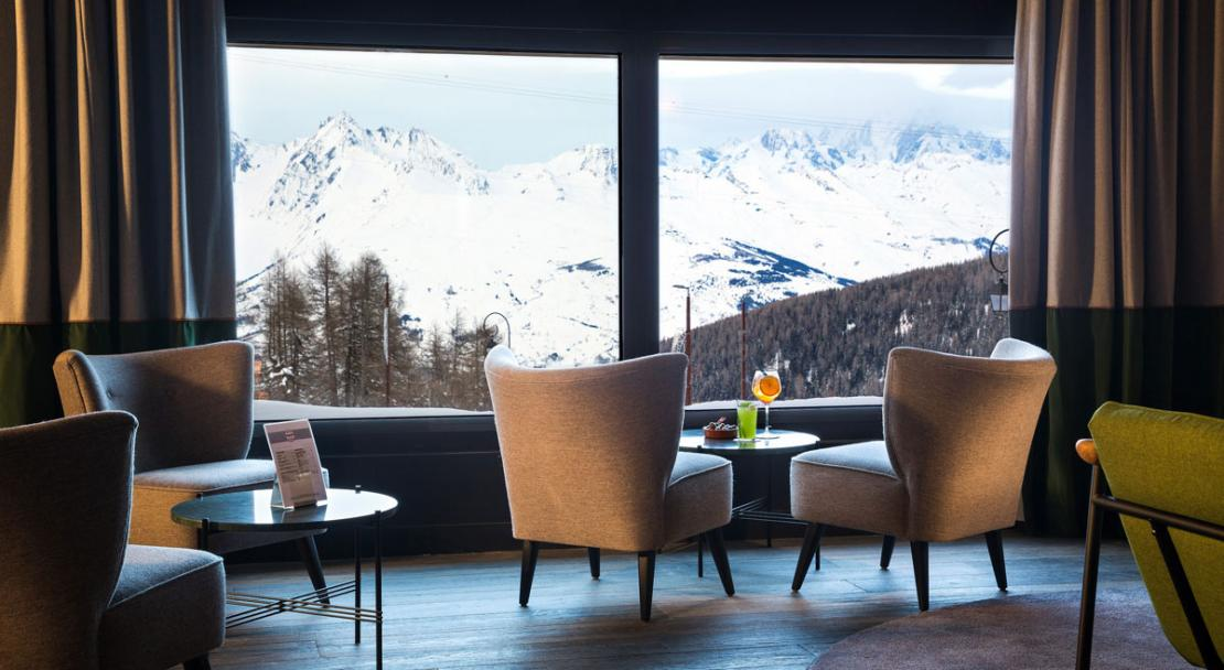 Lobby reception lounge Hotel Araucaria armchairs mountain view La Plagne