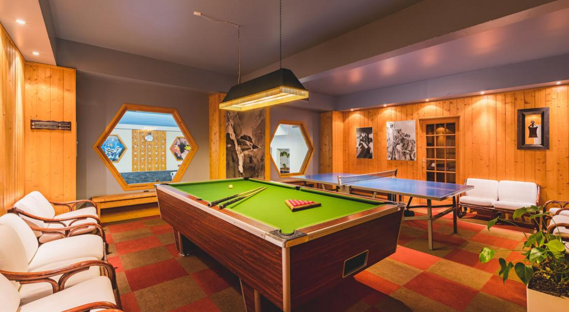 Games rooms ping pong pool table Hotel Les Arolles Meribel Mottaret
