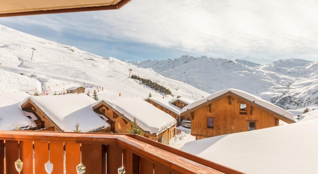 Sunny snowy mountain views from balcony at Les Alpages de Reberty Les Menuires; Copyright: Imagera