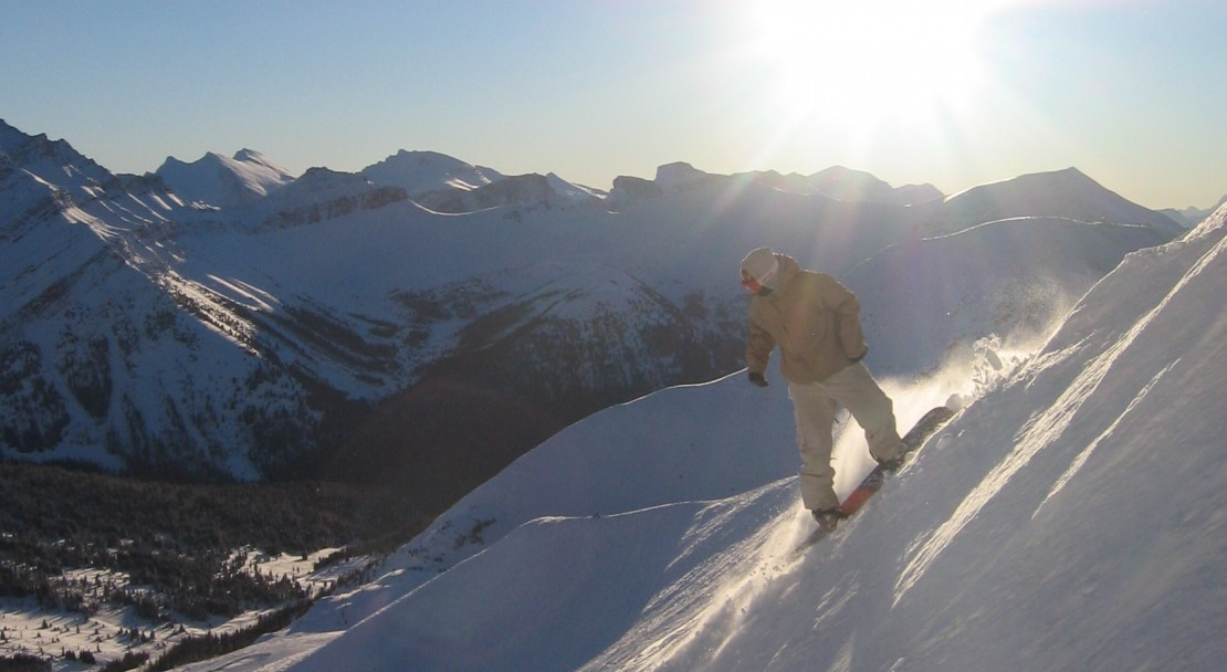 The sun setting on a final jump in Lake Louise; Copyright: Lake Louise Ski Area Mates.  Photo courtesy of the Lake Louise Ski Area