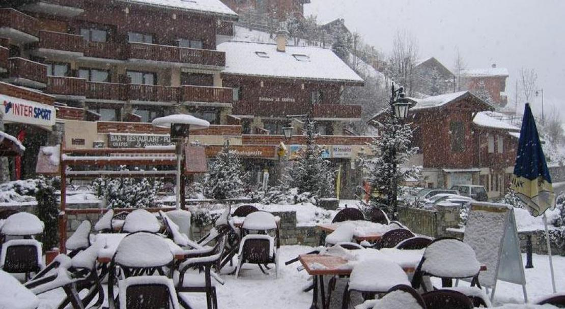 The terrace in the snow at Champagny-en-Vanoise, France; Copyright: Tourist Office in Champagny-en-Vanoise