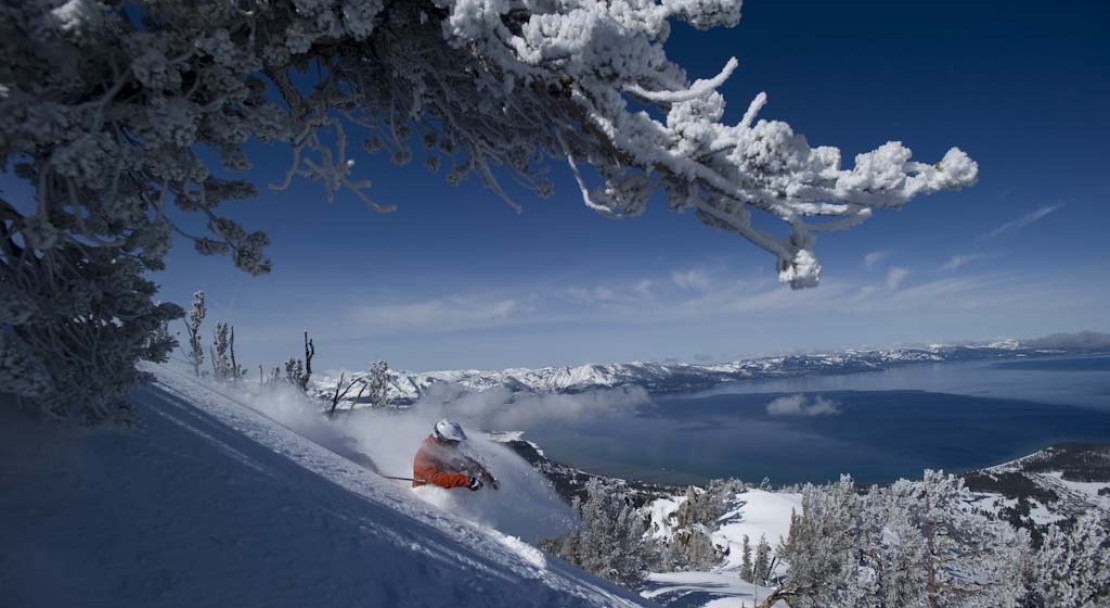 Heavenly Ski Holiday Skier and Lake Tahoe