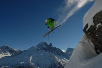 Skier takes on a sizeable rock drop in Chamonix for the Freeride World Tour