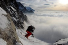Rock drop above the clouds in Argentiere