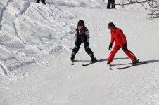 First timers, learning to ski in a La Tania group ski lesson