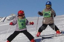 Learning to ski is great fun in one of Valfrejus' kids group ski lessons!