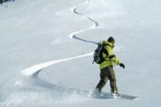 Creating the first tracks down one of Valmorel's untouched slopes