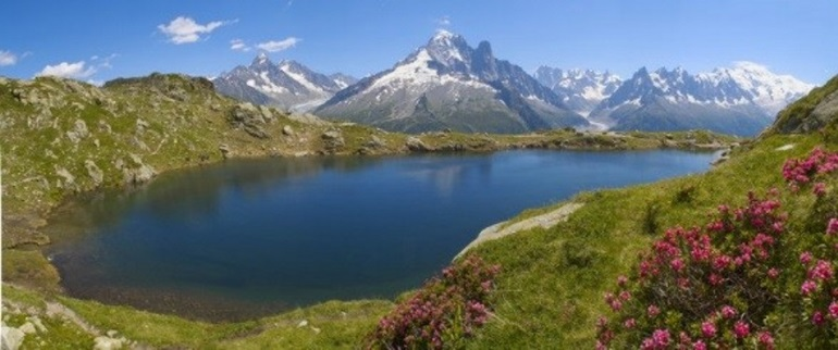 Sunny summer view of a lake in the mountains in Chamonix
