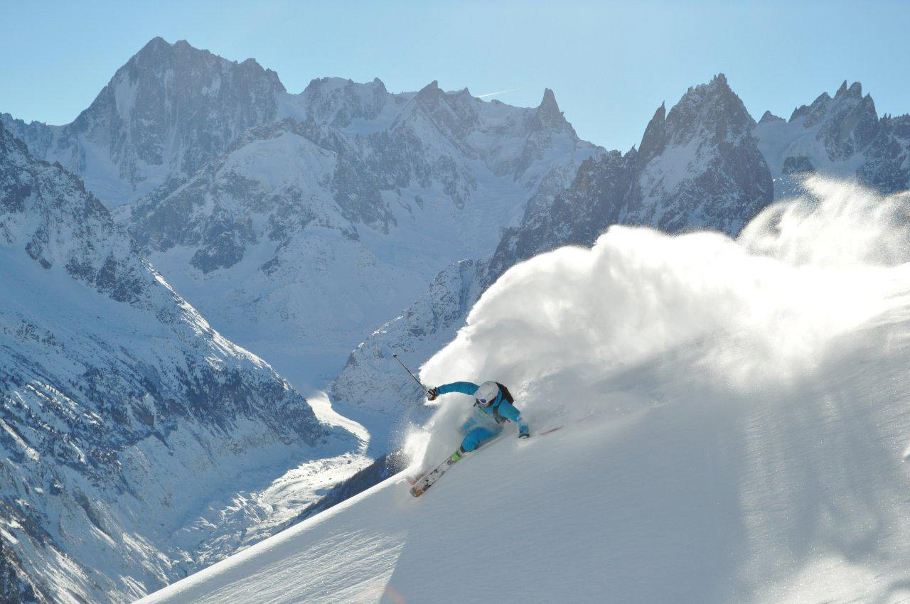 Freeride skier skiing down the mountains in Chamonix