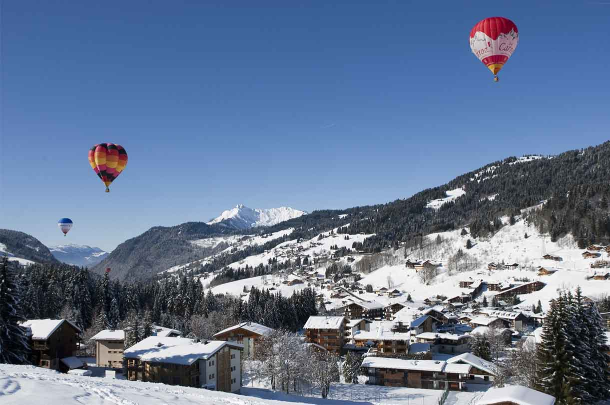 Les gets village with hot air balloons above