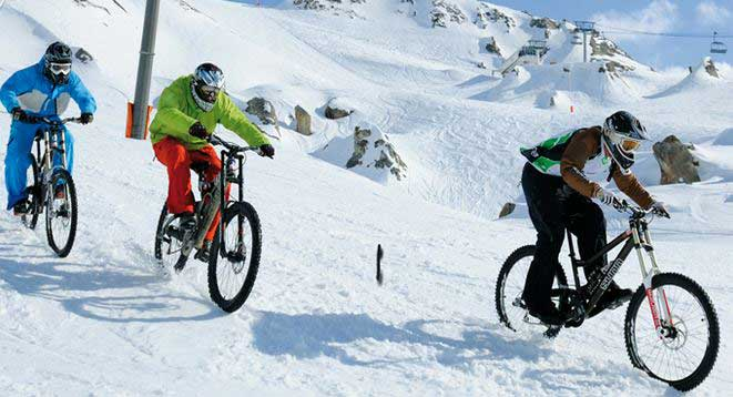Mountain biking in snow Tignes